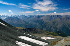 View from the highland pass Karaturek to the Altai Mountains with snowcaps Royalty Free Stock Photography