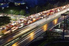 The view of the highway in the eastern city of Jakarta at night. The view of the highway with glittering lights and traffic jams in the eastern city of Jakarta Stock Photos