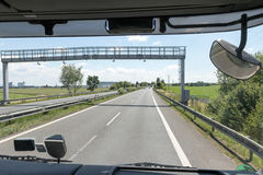 View of the highway toll gate of the truck cab Royalty Free Stock Photography