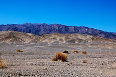 View from highway 190 towards salt flats of Badwater Basin, Death Valley, California royalty free stock photo
