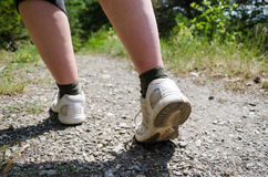 View of hiker legs walking on a path Royalty Free Stock Photo