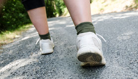 View of hiker legs walking on a path Stock Photo