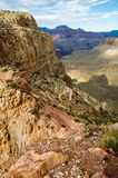 View from hiking path in Grand Canyon. Sun shines at Grand Canyon, Seen from Bright Angel trail to the bottom Royalty Free Stock Image