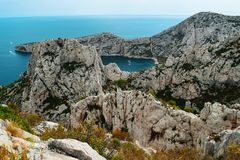 Overview of the Calanque National Park. View from a hiking trail on Mount Puget, in the distance clearly visible is the Calanque de Sormiou with three parked Royalty Free Stock Photo