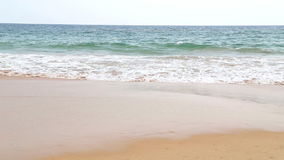 View of Hikkaduwa beach while waves are splashing the sand. stock footage