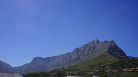 View of the hill, Cape Town. View of the hill, clear blue sky ,  green trees , South Africa Royalty Free Stock Photos