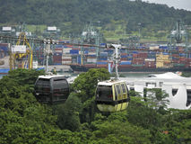 View from the hill on the port of Singapore and cabins of cableway over them. Royalty Free Stock Images