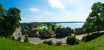 View from the hill on a small town with the lake Stock Photos