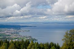 A view from a hill to the Bodensee. On a cloudy  late summer afternoon. Down left part of Switzerland, far away other side of the sea, is Germany Stock Images