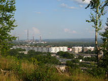 View from a hill to an industrial city Stock Images