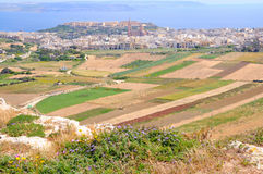 View the hill top in Gozo island, Malta. View to Mgarr bay and Maltese coast from the hill top in Gozo island Stock Photo