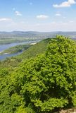 A view from the hill of Visegrad castle to Danube river and a ship, villages and mountains, with a tree at foreground, Visegrad stock photo