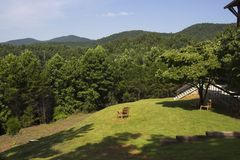 View of the Hills From an Outdoor Chair. From this relaxing chair, you can see the Appalachian foothills and the forest all around. This was taken at Unicoi royalty free stock image