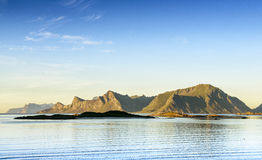 View of the hills in a quiet bay in Lofoten. Royalty Free Stock Images