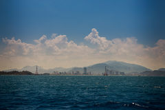 View of hilly islands azure sea against blue sky cumulus clouds Royalty Free Stock Photo