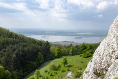View of the hilly landscape of Palava with forests, rocks in South Moravia under a blue sky Stock Photos