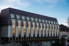View of Hilton Hotel in Budapest. Modern Hilton Hotel at Fisherman`s Bastion in Budapest, Hungary during a sunset with orange light reflected on the windows royalty free stock photography