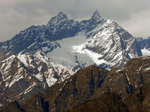 View of Himalayas from Auli, India. View in Auli,India of Himalayas on a cloudy day Stock Photo