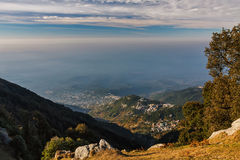 View in Himalayas with cloudy cky. A view on a city from a hill stock photography