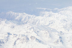 View of the Himalayas mountain range from airplane window. Aerial View Stock Images