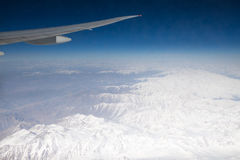 View of the Himalayas mountain range from airplane window. Airplane wing. Aerial view Royalty Free Stock Photography