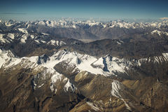 View of the Himalayas mountain range from the airplane window. New Delhi-Leh flight ,India Stock Photos