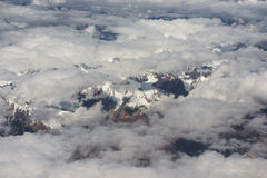 View of the Himalayas mountain range from the airplane window. New Delhi-Leh flight ,India. Stock Photos