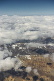 View of the Himalayas mountain range from the airplane window. New Delhi-Leh flight ,India. Royalty Free Stock Photography