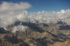 View of the Himalayas mountain range from the airplane window. New Delhi-Leh flight ,India.  Royalty Free Stock Photos