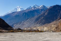 View of the Himalayas and town Jomsom. View of the Himalayas, Dhaulagiri and town Jomsom Royalty Free Stock Photography