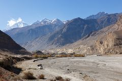 View of the Himalayas and town Jomsom. View of the Himalayas Dhaulagiri and town Jomsom Royalty Free Stock Image