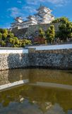 View of Himeji Castle in autumn reflected in pond water. View of Himeji Castle in autumn against the blue  sky and reflected in Mikuni pond, located in Kansai royalty free stock photos