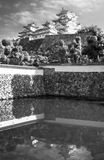 View of Himeji Castle in black and white with reflections in the pool. View of Himeji Castle in black and white against the sky and reflected in Mikuni pond royalty free stock photos