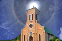 In view of His. Church, cross on holy sky light. Royalty Free Stock Photos