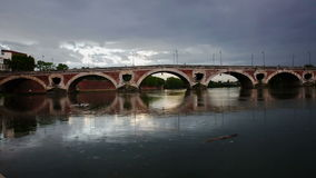 View of the historic bridge across the river Garonne in Toulouse stock footage
