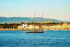 View of historic center of Geneva with a big football ball and y Stock Photography
