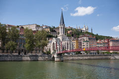 View of the historic centre of Lyon, France. View of the waterfront of the historic centre of Lyon and the red pedestrian bridge across the river, France stock photos
