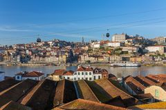 View of the historic city of Porto with cable car and boats on Douro river Stock Photos