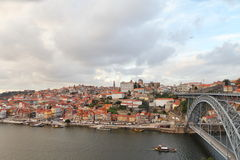 View of the historic city of Porto with the Dom Luis bridge and tourist boat Stock Images