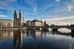 View of historic city of Zurich. Grossmunster Church and Munster. Bucke crossing river Limmat, Canton of Zurich, Switzerland. Europe royalty free stock image