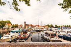 View at the historic harbor with yachts in the Dutch village of Stock Photography
