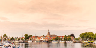 View at the historic harbor with yachts in the Dutch village of. Panoramic view of the historic harbor with yachts in the Dutch village of Blokzijl stock photography