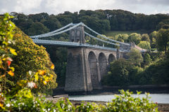 A view of the historic Menai suspension bridge spanning the Mena Stock Image