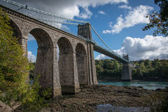 A view of the historic Menai suspension bridge spanning the Mena. I Straits, Gwynnedd, Wales, UK Royalty Free Stock Photos