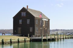 View of historic pier and timber sail loft building in Salem. Massachusetts royalty free stock images