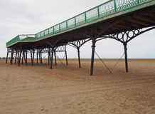View of the historic victorian pier at saint annes on sea in in lancashire with the beach at low tide looking out to sea. A view of the historic victorian pier royalty free stock images