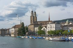 View of historic Zurich city center with Grossmunster Church and Limmat river. Seagull in the sky. royalty free stock photo