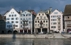 View of historical buildings on Limmat river quay, Zurich, Switzerland Stock Images