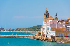 View of the historical center and the church of Sant Bartomeu and Santa Tecla in Sitges, Barcelona, Catalunya, Spain. Stock Image