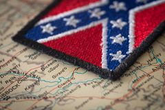 Historical flag of the south of the United States on the background of the USA map. View of the Historical flag of the south of the United States on the Stock Photo